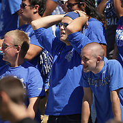 UK students Jared Hicks, left, Adam Schilt and Justin Milles reacts after Louisville scores in the first half as the University of Kentucky plays the University of Louisville at Commonwealth Stadium in Lexington, Ky. Saturday Sept. 14, 2013. Photo by David Stephenson