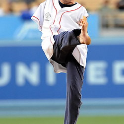 Tom Willis, who was born with no arms, throws out the ceremonial first pitch with his foot prior to a Major League baseball game between the San Diego Padres and the Los Angeles Dodgers in Los Angeles on Saturday, April 30, 2011. Willis is trying to help build awareness for the abilities of people with disabilities.