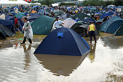 © Licensed to London News Pictures. 23/06/2014. Somersert, UK ***FILE PICTURE***. A wet Glastonbury 2005. The weather forecast for this year's festival is for heavy rain. The festival starts on June 25th 2014. Photo credit : Jason Bryant/LNP