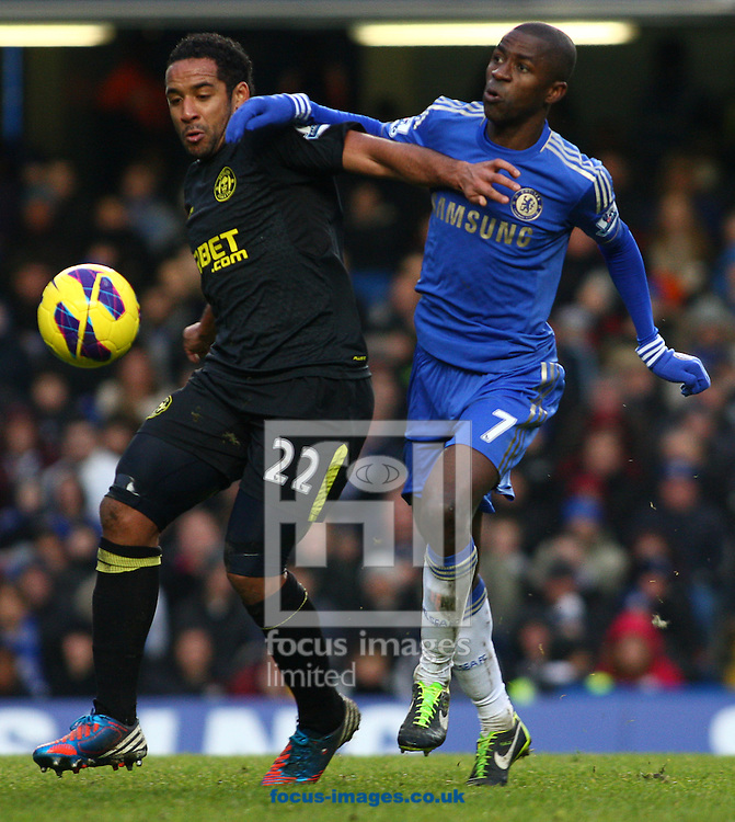 Picture by Rob Fisher/Focus Images Ltd +44 7545 398891.09/02/2013.Ramires of Chelsea holds back Jean Beausejour of Wigan Athletic battle for the ball during the Barclays Premier League match at Stamford Bridge, London.