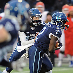 TOM KELLY IV &mdash; DAILY TIMES<br /> Villanova's Kevin Monangai (2) runs the ball on a hand off from QB Chris Polony (12) during the Sam Houston State University at Villanova University NCAA FCS Division 1 - AA quarterfinal game at Villanova Stadium.