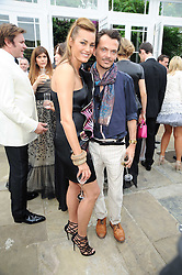 MATTHEW WILLIAMSON and YASMIN LE BON at the Raisa Gorbachev Foundation Party held at Stud House, Hampton Court Palace on 5th June 2010.  The night is in aid of the Raisa Gorbachev Foundation, an international fund fighting child cancer.