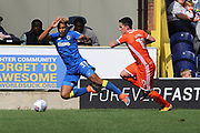 Shrewsbury Town attacker Louis Dodds (10) fouling AFC Wimbledon striker Lyle Taylor (33) during the EFL Sky Bet League 1 match between AFC Wimbledon and Shrewsbury Town at the Cherry Red Records Stadium, Kingston, England on 12 August 2017. Photo by Matthew Redman.