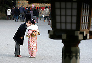 A couple makes their way to a ceremony held for Coming-of-Age Day in Tokyo, Japan. While Japanese women can marry as early as 16 years of age and men at 18, neither is considered to reach adulthood until they reach 20, when they can also legally begin to smoke, drink and vote.ey can also legally begin to smoke, drink and vote.