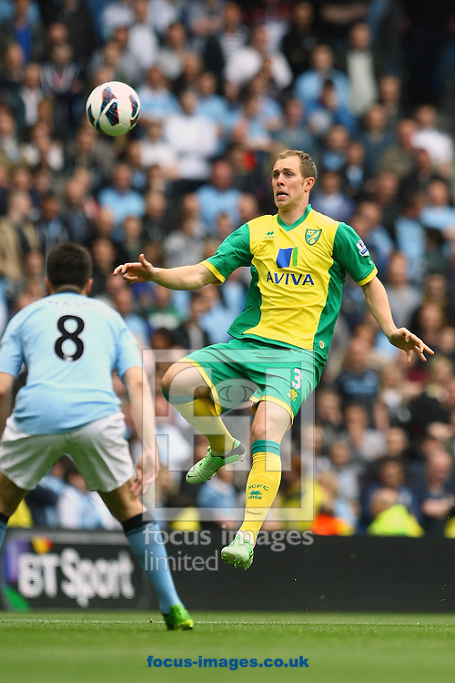 Picture by Paul Chesterton/Focus Images Ltd +44 7904 640267.Steven Whittaker of Norwich and Samir Nasri of Man City in action during the Barclays Premier League match at The Etihad Stadium, Manchester.
