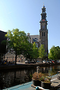 "The Westerkerk (""western church"") is a Protestant church in Amsterdam, built in 1620-1631 after a design by Hendrick de Keyser. The church is in Amsterdam's Jordaan district, at the bank of the Prinsengracht canal.<br />