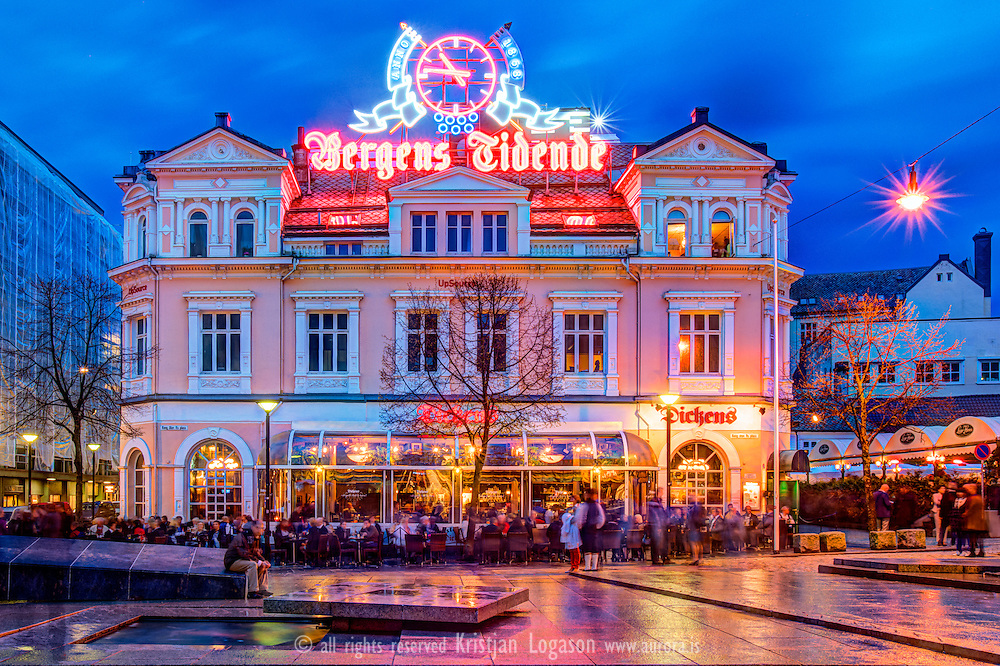 Evening at Torgalmenningen with view over Bergens tidende sign and Dickens restaurant in central Bergen