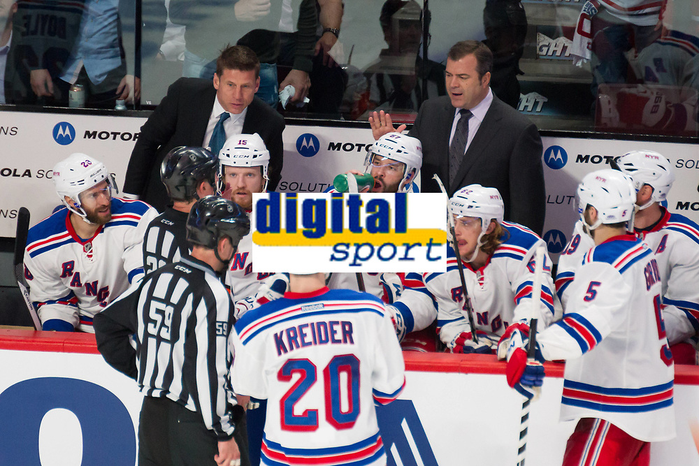 27 May 2014 New York Rangers Head Coach Alain Vigneault Talks with Referee Brad Watson 23 and Linesman Steve Barton 59 during Game Five of The Eastern Conference Final during The 2014 NHL Ice hockey men USA Stanley Cup Playoffs between The Montreal Canadians and The New York Rangers AT The Bell Centre in Montreal Quebec Canada NHL Ice hockey men USA May 27 Eastern Conference Final Rangers AT Canadiens Game 5 <br />