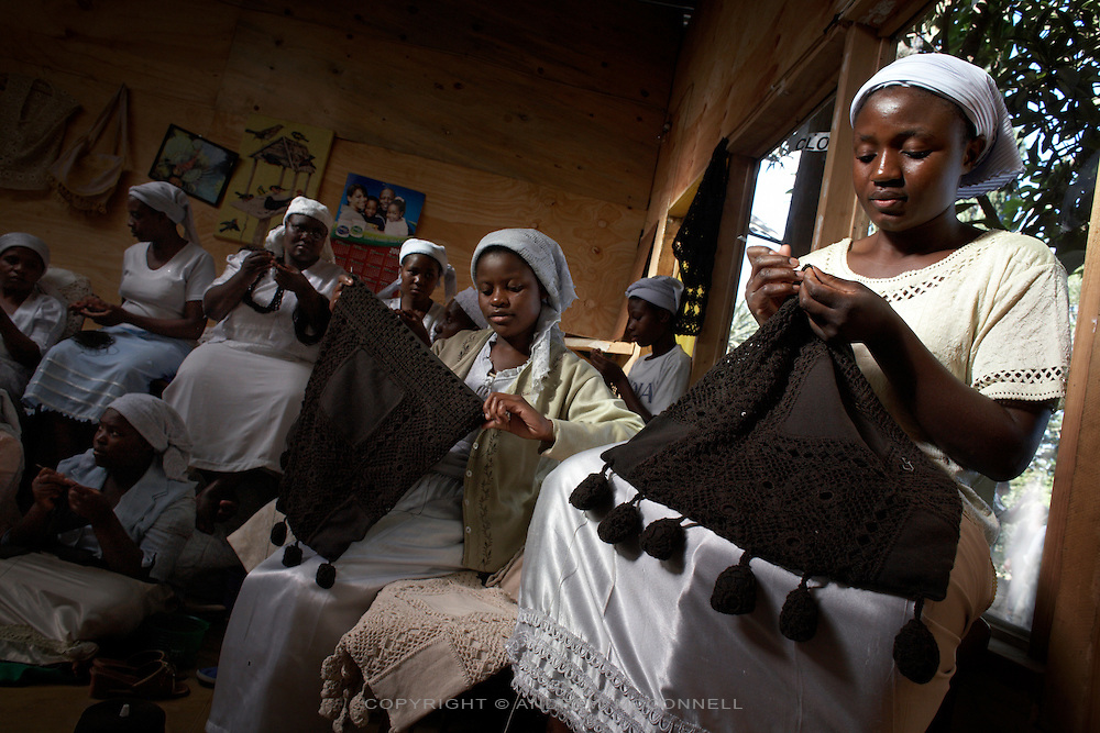 "The ""Crochet Sisters"" working on the MAX&Co. range in Nairobi, Kenya, on Thursday, Jan. 15, 2009. The group is made up of some 200 women from Zimbabwe many of whom have fled that country and are now refugees. They are members of the Church of the Gospel of God and are true experts in the art of crochet, producing hand-made one-of-a-kind shoulder-bags, cases and scarfs."