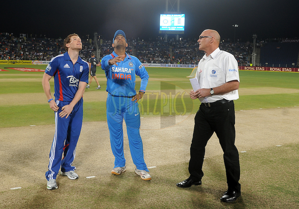 Eoin Morgan captain of England and MS Dhoni captain of India during the toss before the start of the match during the first Airtel T20 Match between India and England held at Subrata Roy Sahara stadium in Pune on the  20th December 2012..Photo by  Pal Pillai/BCCI/SPORTZPICS .