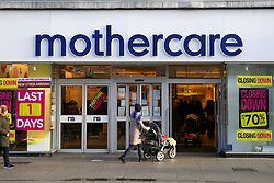 © Licensed to London News Pictures. 09/01/2020. London, UK. A woman with a pram enters a branch of mother and baby retailer, Mothercare, in Wood Green, north London which is to close in one day. All 79 Mothercare stores are set to close by Sunday 12 January 2020 - putting 2,500 people out of work after the company went into administration last year. Photo credit: Dinendra Haria/LNP