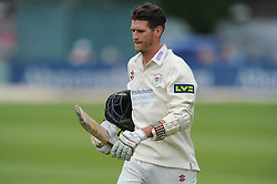 David Payne of Gloucestershire cuts a dejected figure as he is caught out by Rory Burns of Surrey for 21 - Mandatory byline: Dougie Allward/JMP - 07966386802 - 21/08/2015 - Cricket - County Ground -Bristol,England - Gloucestershire CCC v Surrey CCC - LV= COUNTY CHAMPIONSHIP