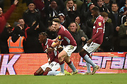 Aston Villa striker(on loan from Chelsea) Tammy Abraham (18) appears in pain as he celebrates his goal 2-2 during the EFL Sky Bet Championship match between Aston Villa and Nottingham Forest at Villa Park, Birmingham, England on 28 November 2018.