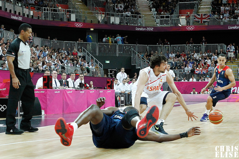 02 August 2012: Spain Sergio Llull vies for the loose ball with Luol Deng and Andrew Lawrence during 79-78 Team Spain victory over Team Great Britain, during the men's basketball preliminary, at the Basketball Arena, in London, Great Britain.