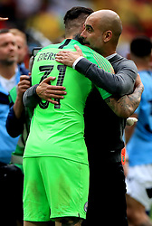 Manchester City's goalkeeper Ederson (left) and manager Pep Guardiola (right) celebrates victory after the FA Cup Final at Wembley Stadium, London.