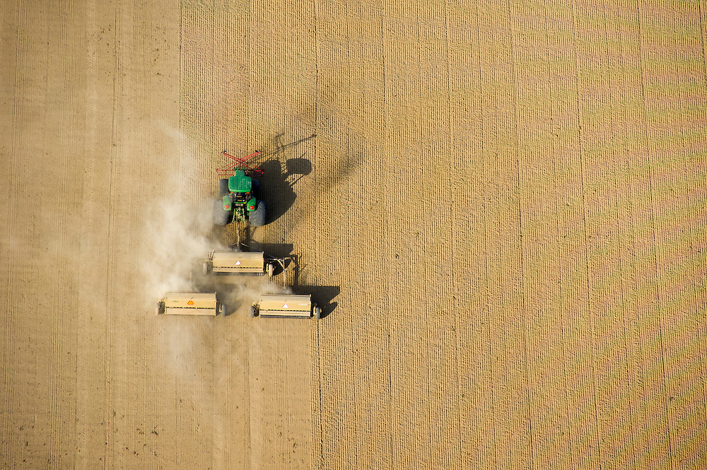 Aerial view of Farmer planting with grain drill on the eastern shore of MD