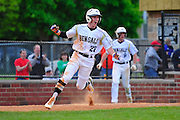 Oak Forest's Kevin Johnson celebrates after scoring the winning run against Tinley Park and clinching the South Suburban Blue Conference Championship. Friday, May 22nd, 2015, in Oak Forest. (Gary Middendorf-Daily Southtown)