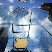 The Apple Logo, on the glass fronted Apple Store, surrounded by the high rise buildings of Manhattan opposite Central Park on Fifth Avenue, Manhattan, New York, USA.  Photo Tim Clayton