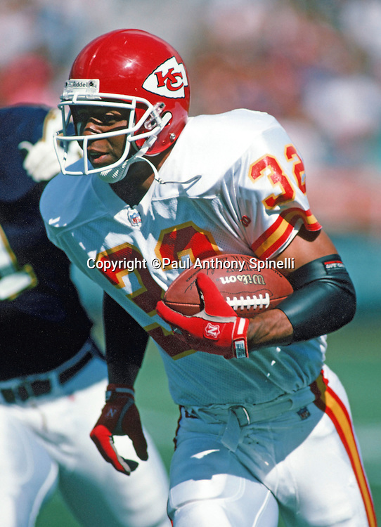 Kansas City Chiefs running back Marcus Allen (32) runs the ball during the NFL football game against the San Diego Chargers on Oct. 17, 1993 in San Diego. The Chiefs won the game 17-14. (©Paul Anthony Spinelli)