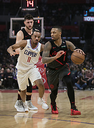 December 17, 2018 - Los Angeles, California, United States of America - Avery Bradley #11 of the Los Angeles Clippers is unable to defend against Damian Lillard #0 of the Portland Trailblazers during their NBA game on Monday December 17, 2018 at the Staples Center in Los Angeles, California. Clippers lose to Trailblazers, 127-131. JAVIER ROJAS/PI (Credit Image: © Prensa Internacional via ZUMA Wire)