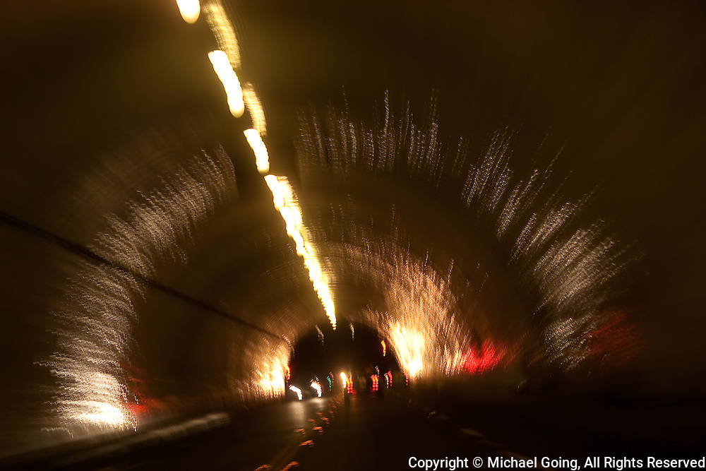 Motion blur inside a tunnel with light streaks and blurred cars