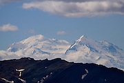 "At 6194m, Denali, or Mount McKinley, or simply ""The Mountain"" is the highest peak in North America, with a higher rise than even Mount everest. Even though the summit of Everest is about 9,000 feet (2,700 m) higher as measured from sea level, its base sits on the Tibetan Plateau at about 17,000 feet (5,200 m), giving it a real vertical rise of little more than 12,000 feet (3,700 m). The base of Mount McKinley is roughly a 2,000-foot plateau, giving it an actual rise of 18,000 feet (5,500 m).....Denali National Park, Alaska.."