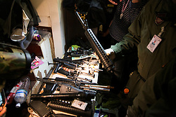 © Licensed to London News Pictures. 17/01/2014. Army Personnel picks up a gun attachment found in the the apartment housing the suspect whom threw an explosive device injuring eight people during an anti-government street rally on January 17, 2014 in Bangkok, Thailand. Anti-government protesters launch 'Bangkok Shutdown', blocking major intersections in the heart of the capital, as part of their bid to oust the government of Prime Minister Yingluck Shinawatra ahead of elections scheduled to take place on February 2. Photo credit : Asanka Brendon Ratnayake/LNP