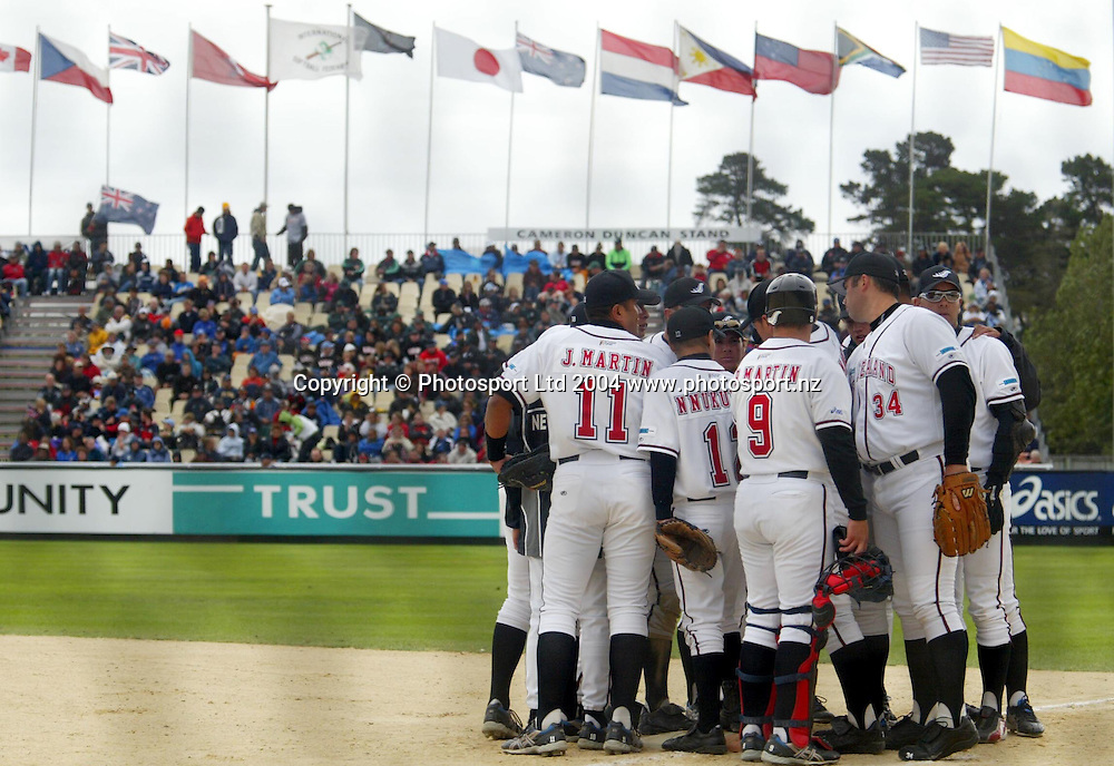 7th February 2004, ISF Men's Softball World Championships, Christchurch, New Zealand.<br />NZ Black Sox vs Team Canada.<br />BlackSox  have a team huddle.<br />Pic: Sandra Teddy/Photosport