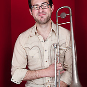 Portrait of Nicholas Daley, trombonist for  Rumbankete, a Los Angeles, California-based salsa orchestra, taken in Woodland Hills, Calif., on April 3, 2010, for the band's promotional use and album cover.  Photo by Jen Klewitz.  (Jen Klewitz © 2010)