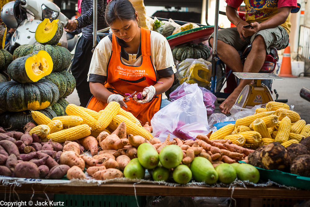 09 JULY 2013 - PATTANI, PATTANI, THAILAND:  A vegetable vendor in the market in Pattani.  Pattani, along with Narathiwat and Yala, are the only three Muslim majority provinces in Thailand.     PHOTO BY JACK KURTZ