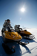 Simon Auclair (on the left)  -24 Melissa o(on the right) Battler -26 driving snowmobile on the way to a mission out from The FMARS (Flashline Mars Arctic Research Station) laboratory,..On Devon Island Canada....Mars flashline Mars arctic (FMARS)....On Devon Island in the high Canadian Arctic a group of sciences from the USA & Canada is gathering for four month to search watt human being can do on mars planet...The four month mission will be the first time that a simulated Mars mission has ever been conducted for such a long duration...The crow of volunteers includes some biologist geologist and other nether scientist researches.....They chose Devon Island in Canada because it simulated the acclaim on the planet Mars, for getting the filling of being on Mars and to challenge the research and to make it close as they can to the conditions on the planet they wear spies suit and live isolated in the laboratory for four month...The man person that ran the project is Dr Robert Zabrin that believe that this project can lied to find ways to search for life on Mars and maybe to fined a way that human being will be able to live on the planet.....This project is privet projects that cooperate with several universities around the world.....
