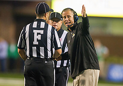 Oct 9, 2015; Huntington, WV, USA; Southern Miss Golden Eagles head coach Todd Monken argues a call during the first quarter against the Marshall Thundering Herd at Joan C. Edwards Stadium. Mandatory Credit: Ben Queen-USA TODAY Sports