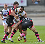 Manase Manuokafoa of Bradford Bulls runs at Daniel Smith (L) & Nick Scruton (R) of Wakefield Trinity Wildcats during the First Utility Super League match at Odsal Stadium, Bradford<br /> Picture by Richard Land/Focus Images Ltd +44 7713 507003<br /> 01/06/2014