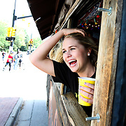BanjoBilly_254.JPG CU sophomore Kendyl Bachelor yells out the window of Banjo Billy's bus tour in Boulder on Wednesday afternoon. Bachelor joined other CU students on the bus tour as subjects in the production of the pilot episode of Campus Cruisin'. .To watch a video of the Campus Crusin' production shoot on Banjo Billy's bus tour go to www.dailycamera.com. .Wednesday, Oct. 13, 2010..SAM HALL / Camera