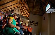 South African and Dutch supporters watching a soccer game on television during the world cup soccer in South Africa.<br /> Zuid-Afrikaanse en Nederlandse supporters kijken naar een voetbalwedstrijd op televisie, tijdens het WK Voetbal in Zuid-Afrika