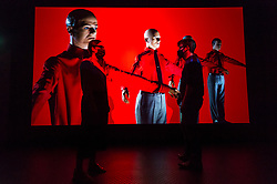"© Licensed to London News Pictures. 28/07/2020. CITY, UK.  Staff members pose in front of the 3D video installation ""12345678"", 2017, by Kraftwerk.  Preview of ""Electronic: From Kraftwerk to The Chemical Brothers"" at the Design Museum in Kensington which is reopening after coronavirus lockdown.  The new exhibition explores the hypnotic world of electronic music, from its origins to its futuristic dreams.  The show runs 31 July 2020 – 14 February 2021 with visitors required to adhere to strict social distancing guidelines.  Photo credit: Stephen Chung/LNP"