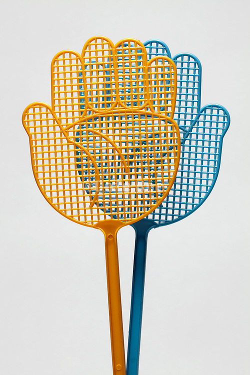 fly swatters in hand form