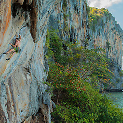 Luke Hudson climbing beside the beautiful Andaman Sea on the secluded island of Lao Liang, Trang Province, Thailand