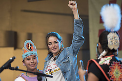 """October 23, 2016 - Los Angeles, California, United States - Actress and activist, Shailene Woodley (C), at a Climate Revolution rally in Los Angeles, California. October 23, 2016. The rally is part of a series of """"Climate Revolution"""" rallies held across the country to inform people about issues related to climate change and social justice. (Credit Image: © Ronen Tivony/NurPhoto via ZUMA Press)"""