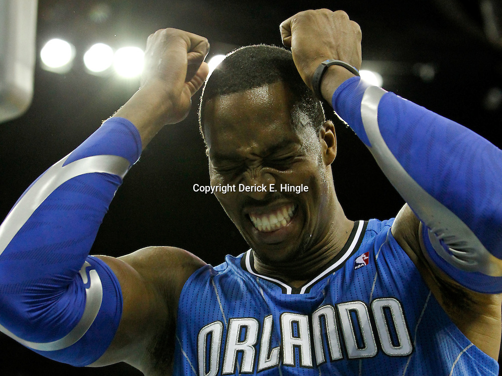 January 27, 2012; New Orleans, LA, USA; Orlando Magic center Dwight Howard (12) reacts to a missed basket against the New Orleans Hornets during the second half of a game at the New Orleans Arena. The Hornets defeated the Magic 93-67.  Mandatory Credit: Derick E. Hingle-US PRESSWIRE