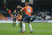 York City forward Vadaine Oliver and Luton Town defender Luke Wilkinson  battle for the ball during the Sky Bet League 2 match between Luton Town and York City at Kenilworth Road, Luton, England on 10 October 2015. Photo by Simon Davies.