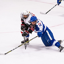 GEORGETOWN, ON - MARCH 2: Thomas Hernandez #16 of the Georgetown Raiders battles for the puck with Matthew Couto #14 of the Markham Royals March 2, 2019 at Gordon Alcott Memorial Arena in Georgetown, Ontario, Canada.<br /> (Photo by Dave Fryer / OJHL Images)