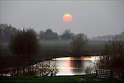 Nederland, Slijk-Ewijk, 12-4-2015Landschap langs de Waal bij ondergaande zon.Foto: Flip Franssen