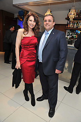NEIL SWAN Chief Executive of Starlight and EMMA SAMMS at the launch of the 2009 Derby Festival in the presence of HRH Princess Haya of Jordan in aid of the charity Starlight held at the Kensington Roof Gardens, 99 Kensington High Street, London W8 on 12th May 2009.