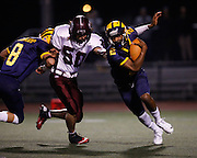 Milpitas' wide receiver Tre Hartley (2) carries the ball for a run as David Kruskamp (8) blocks Piedmont Hills' tackle Bubba Deming (50) during the CCS Division 1 playoff game at Milpitas High School in Milpitas, California, on November 29, 2013. No. 2 Milpitas beat No. 3 Piedmont Hills 45-0. (Stan Olszewski/SOSKIphoto)