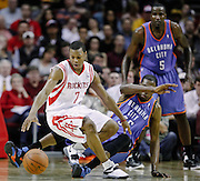 Feb 15, 2012; Houston, TX, USA; Oklahoma City Thunder small forward Kevin Durant (35) fouls Houston Rockets point guard Kyle Lowry (7) during the second quarter at the Toyota Center. Mandatory Credit: Thomas Campbell