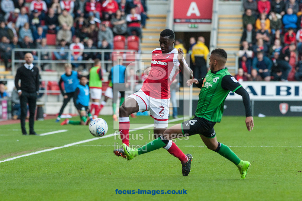 Funso Ojo of Scunthorpe United tackles Josh Emmanuel of Rotherham United during the Sky Bet League 1 Play-Off Semi-Final match at the New York Stadium, Rotherham<br /> Picture by Matt Wilkinson/Focus Images Ltd 07814 960751<br /> 16/05/2018