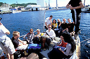 A group of people relaxing on a boat, Kristiansands Norway 2000