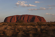 The front of Ayers Rock in Australia at sunset. photograph by Dennis Brack