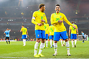 \Brazil forward Neymar Jr (10) celebrates with Brazil forward Roberto Firmino (20) after scoring the first goal of the match during the Friendly International match between Brazil and Uruguay at the Emirates Stadium, London, England on 16 November 2018.